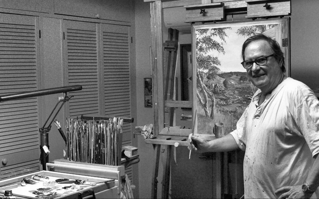 Artist in front of the easel